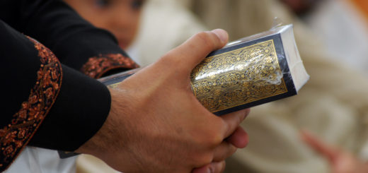 Community Quran in hands